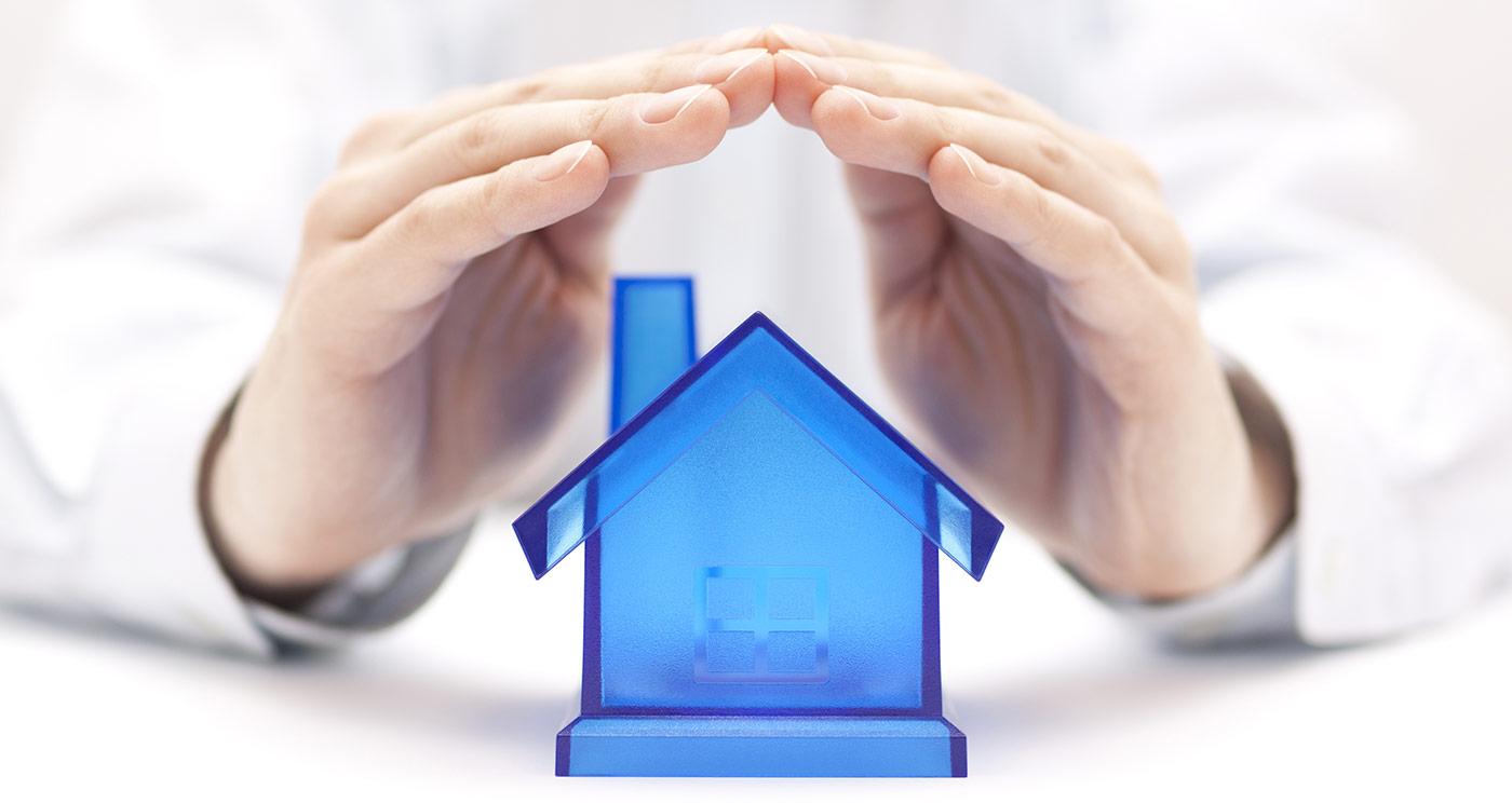 maison protégée par des mains